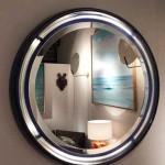 Miroir rond éclairant en résine, travail italien des années 1960